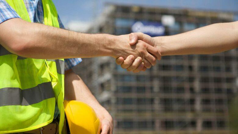 General contractor shaking hands with client in Lakewood, CO