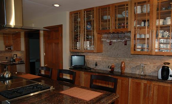 Kitchen Remodeling in Denver with center island stove and bar seating