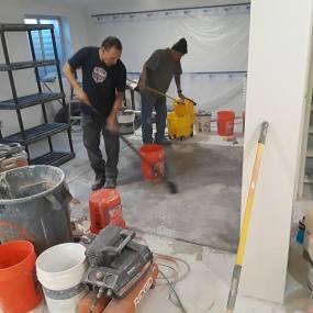 Construction Company workers preparing concrete floors