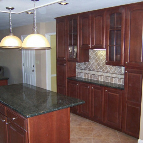 Kitchen remodeling cherry cabinets and island with bar
