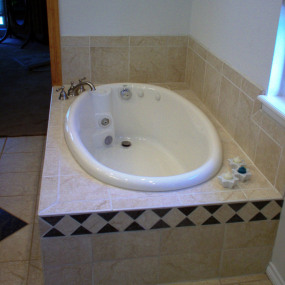 Deep soaker tub installed after bathroom renovations in Denver
