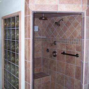 Walk in shower with bench seating for aging in place remodeling in Denver