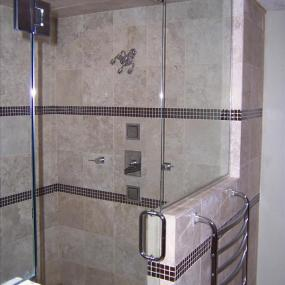 Shower with upgraded showerhead and custom tiling
